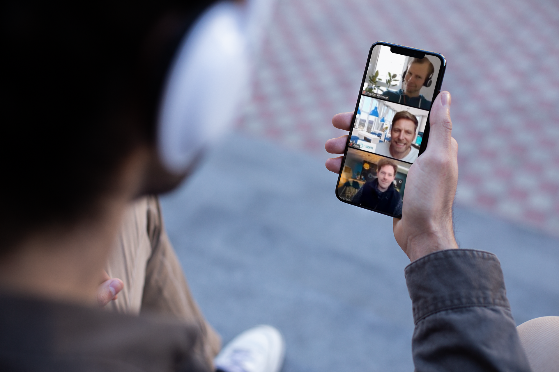 mockup-for-a-podcast-with-a-man-wearing-headphones-and-holding-an-iphone-xs-max-24811 (1)